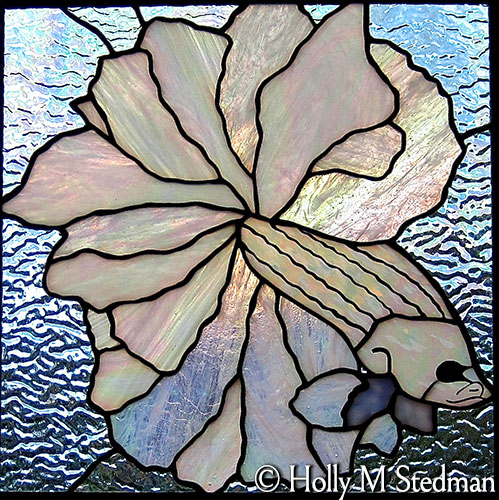 Stained glass panel of a white fish