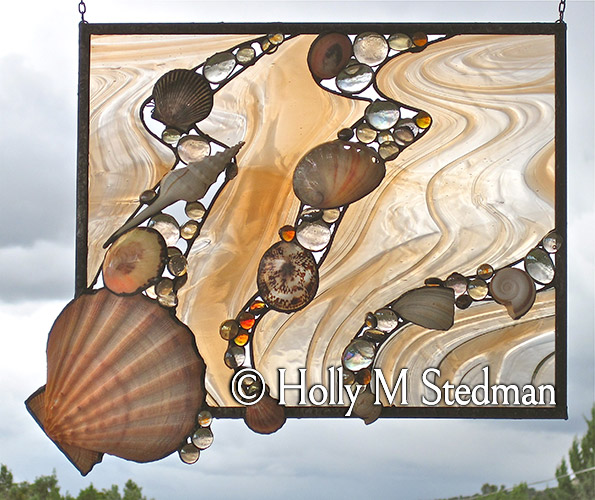 Stained glass panel with shells and tan highlights