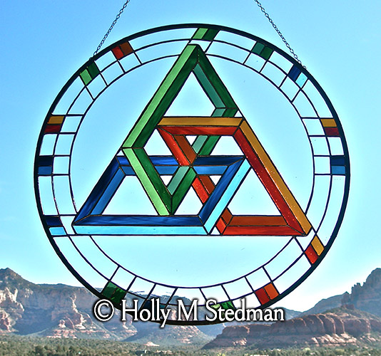 Circular stained glass panel with geometric design