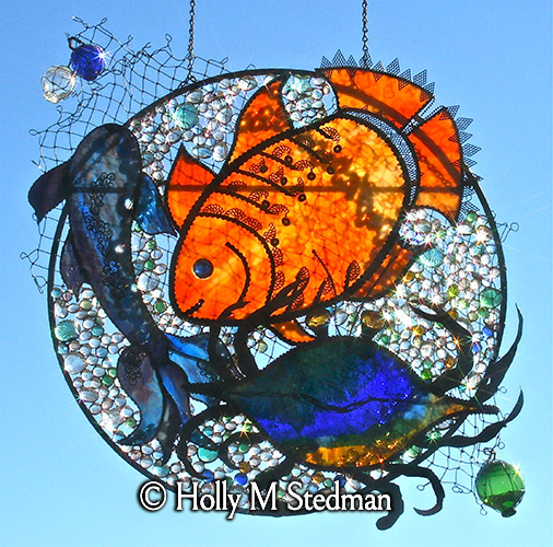 Circular stained glass panel with sea creatures