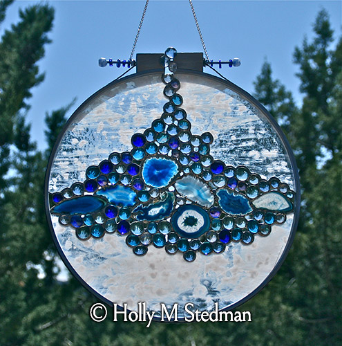 Circular stained glass panel with blue nuggets