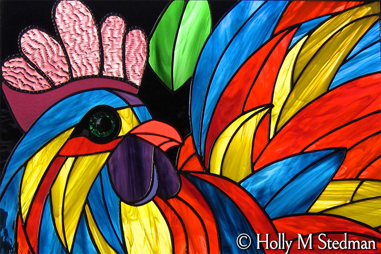 Colorful stained glass panel of a rooster