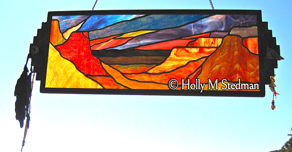 Framed stained glass panel of the Grand Canyon with feathers