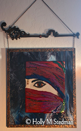 Framed fused glass panel of a woman