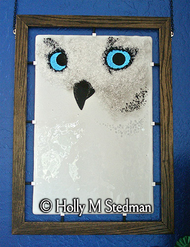 Framed fused glass panel of a white owl