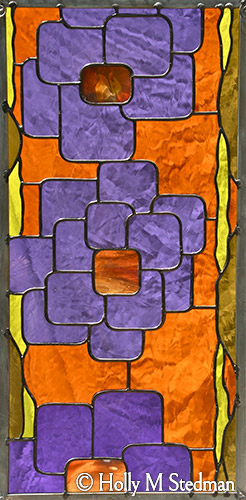 Stained glass panel with geometric flowers