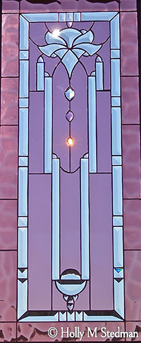Stained glass panel with elegant bevel design