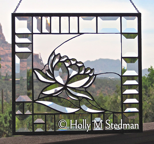 Stained glass panel with elegant bevelled flower design