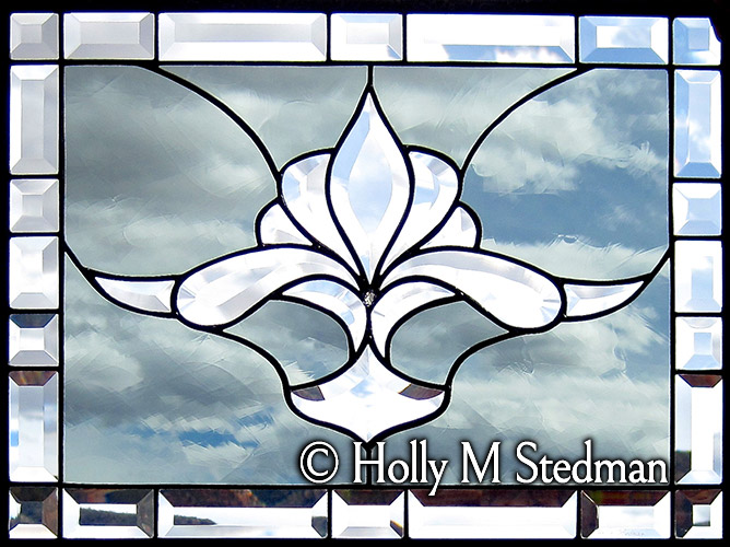Stained glass panel with flowing bevel design