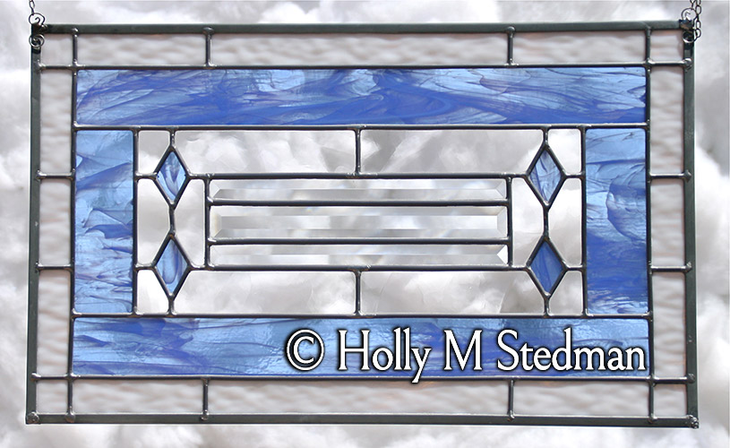 Stained glass panel with white and blue elements