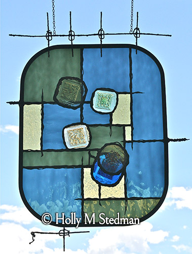 Geometric stained glass panel with strong lines and a rounded frame