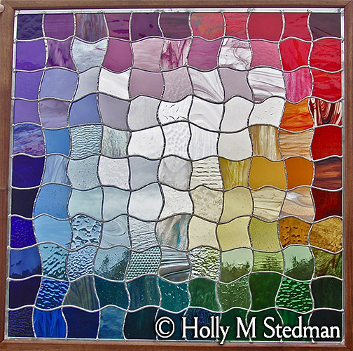 Patchwork stained glass panel with many colors
