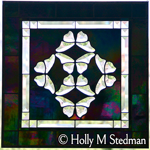Stained glass panel with bevelled butterflies
