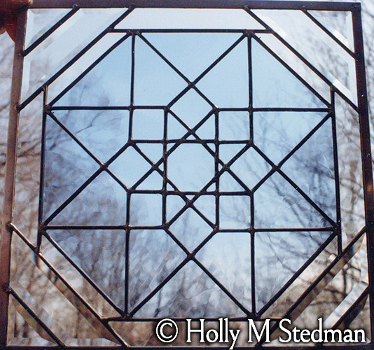 Stained glass panel with star pattern