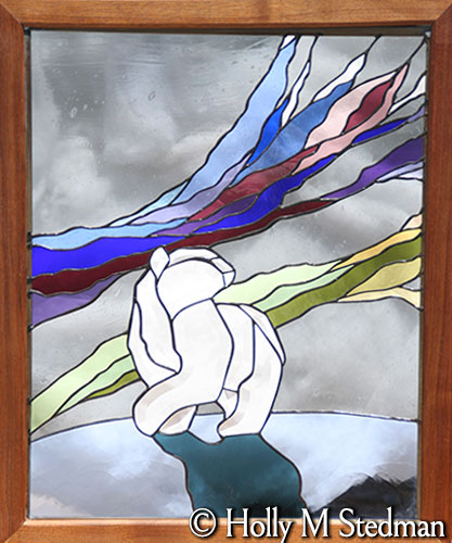 Framed stained glass panel of a polar bear and the nothern lights
